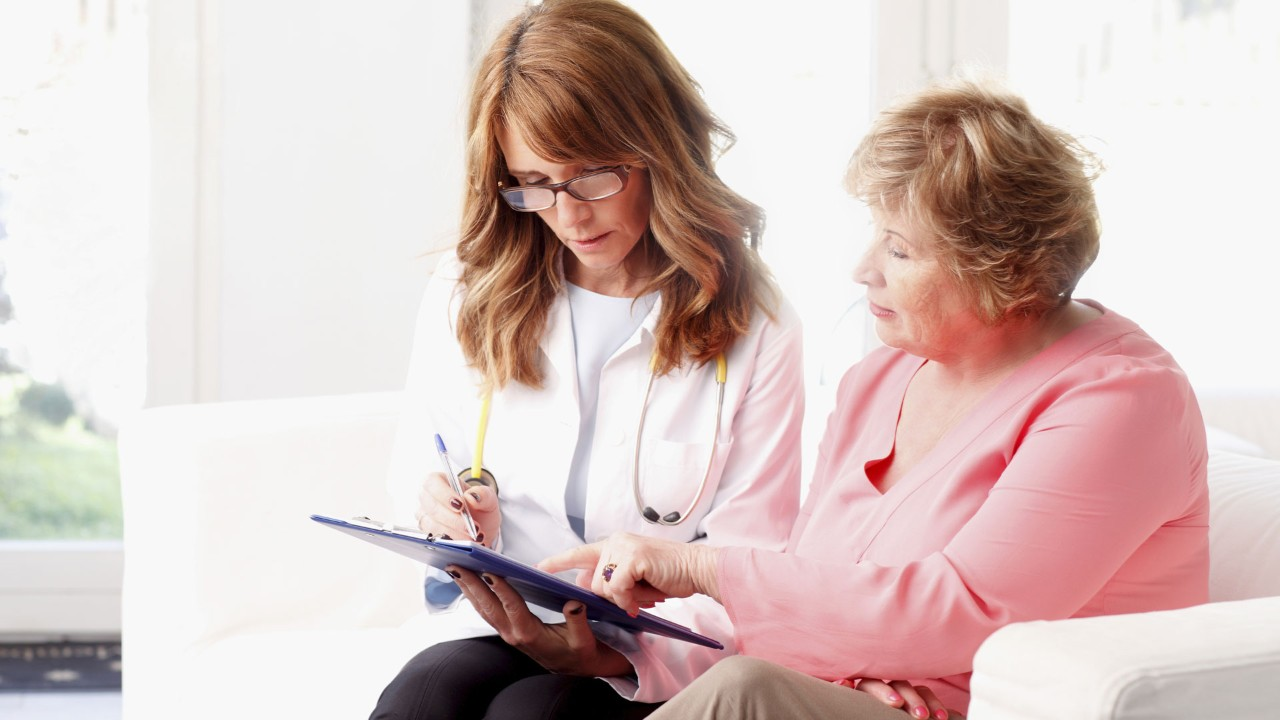 Doctor Reviewing Reports With Patient