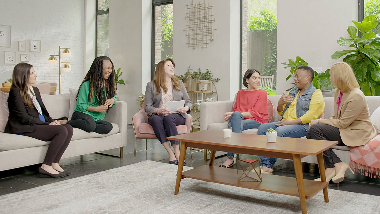 group of women discussing bathroom-related MS symptoms
